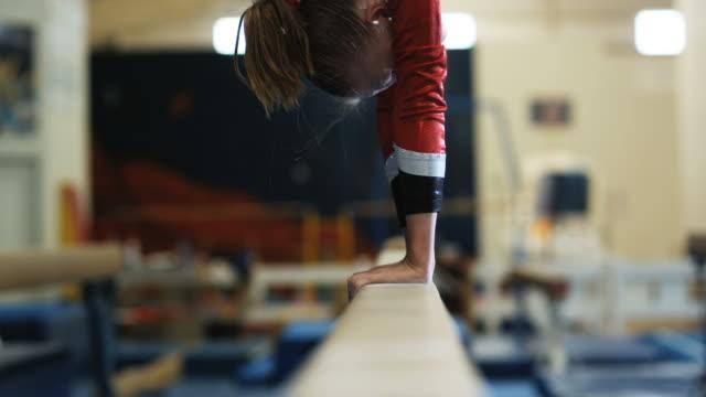 CU TU Girl (12-13) performing gymnastics on the balance beam / Lindon, Utah, USA.