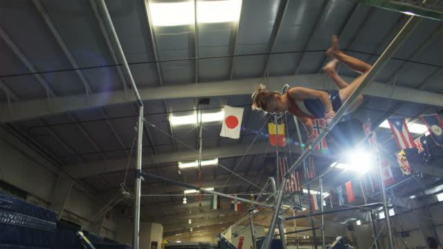 WS Girl (12-13) performing gymnastics on the high bar / Lindon, Utah, USA.