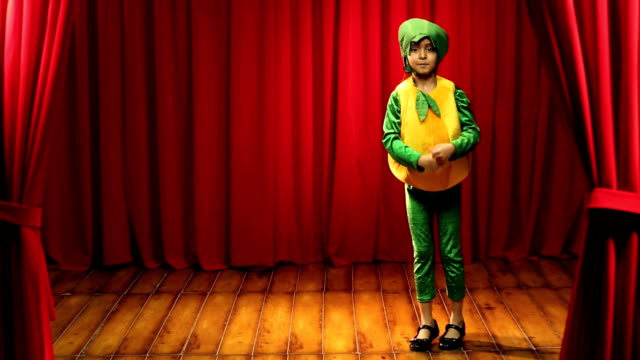 stockvideo's en b-roll-footage met ms girl performing on stage wearing bell pepper costume during annual day - alleen één meisje