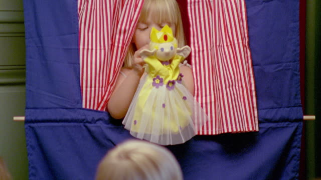 CU, Girl (2-3) performing puppet show, Saint Ferme, Gironde, France