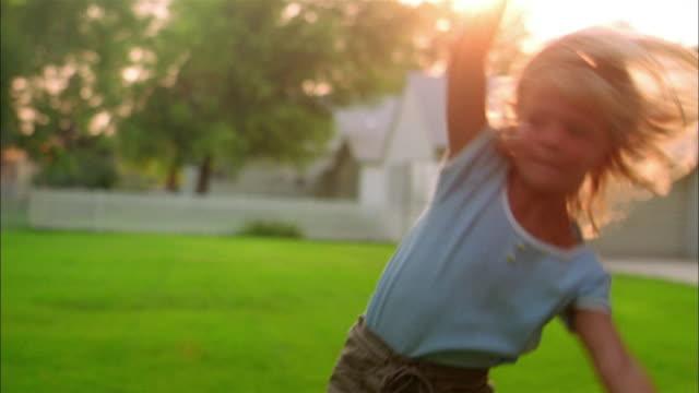 a girl performs cartwheels in her yard. - cartwheel stock videos & royalty-free footage