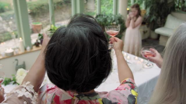 girl photographing wedding guests - ウィルトシャー州点の映像素材/bロール