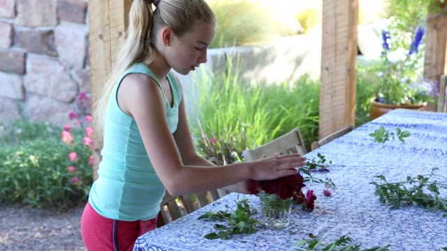 girl picking and arranging flowers from her garden - tablecloth stock videos & royalty-free footage