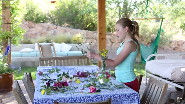 girl picking and arranging flowers from her garden - pre adolescent child stock videos and b-roll footage