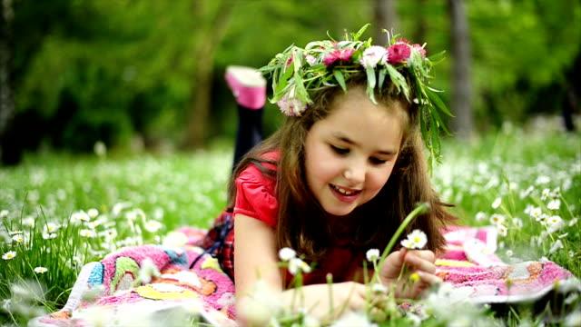 Girl picking flowers. Slow motion.