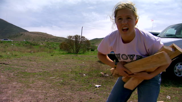 girl picking up wood  - missionary stock videos & royalty-free footage