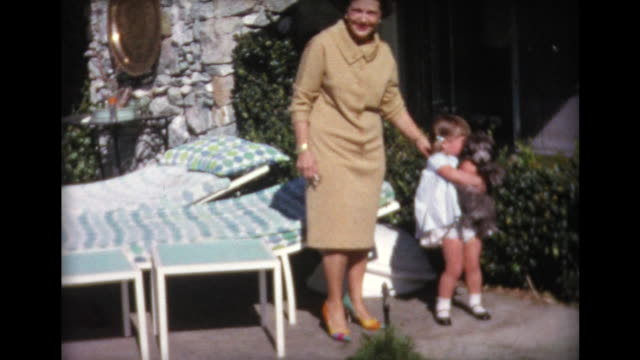 1965 girl picks up dog - pets stock videos & royalty-free footage