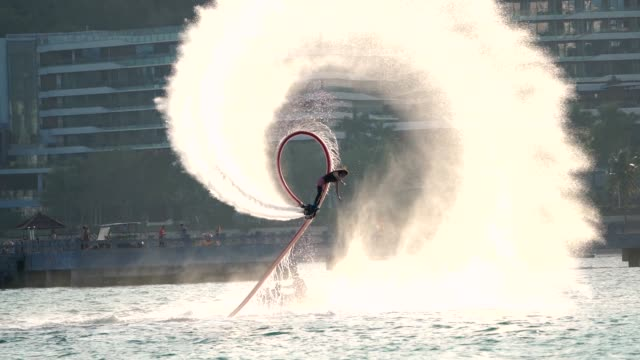 stockvideo's en b-roll-footage met meisje spelen fly board in slow motion - acrobatiek