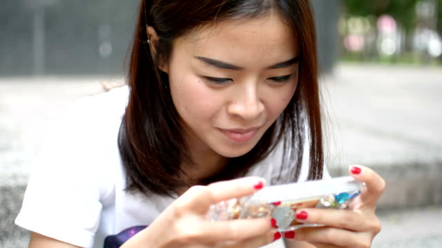 Girl play games on the Smart phone