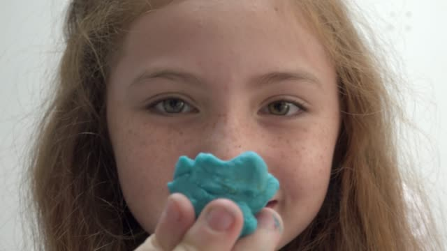 girl play with clay look at camera - clay stock videos & royalty-free footage