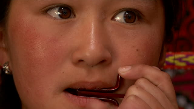 girl playing a jew's harp - human mouth stock videos & royalty-free footage