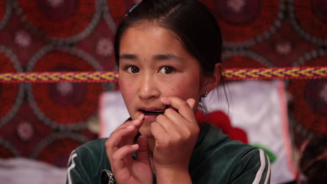 girl playing a jew's harp - kazakhstan stock videos and b-roll footage