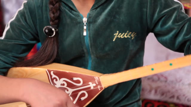 girl playing a two stringed instrument called topshur - stringed instrument stock videos & royalty-free footage