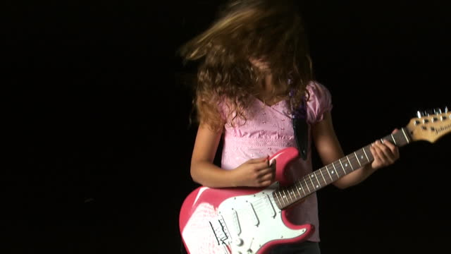 girl playing an electric guitar - see other clips from this shoot 1162 stock videos & royalty-free footage