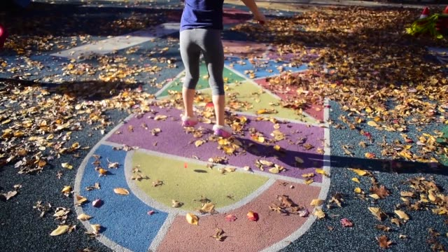 a girl playing hopscotch at the park. - children only stock videos & royalty-free footage