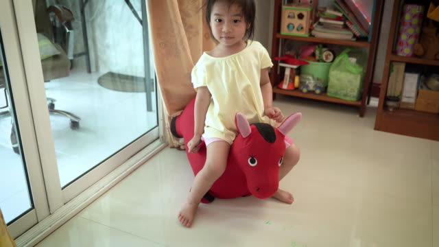 girl playing horse toy - cambodia stock videos and b-roll footage