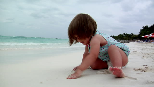 ws girl (18-23 months) playing in sand on beach, isla mujeres, quintana roo, mexico - 18 23 months stock videos & royalty-free footage