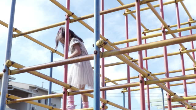 girl playing in the park - climbing frame stock videos & royalty-free footage