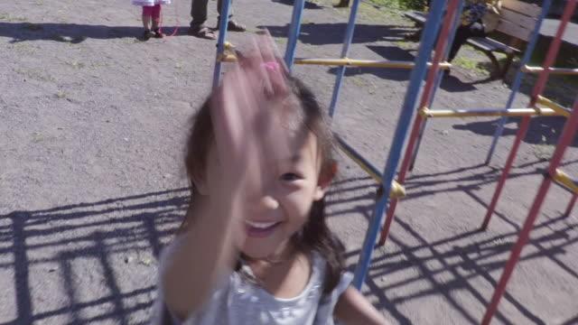 girl playing in the park - braccio umano video stock e b–roll