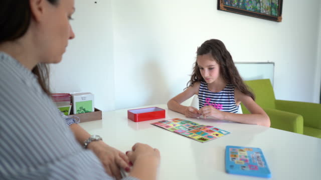 girl playing memory game at occupational therapy session - invisible disability stock videos & royalty-free footage