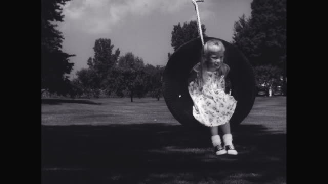 ws girl playing on tire swing / united states - tyre swing stock videos & royalty-free footage