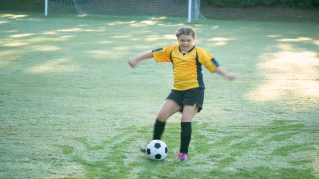girl playing soccer, passing the ball - soccer uniform stock videos & royalty-free footage