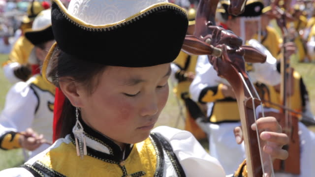 girl playing string instrument - morin khuur - string instrument stock videos and b-roll footage
