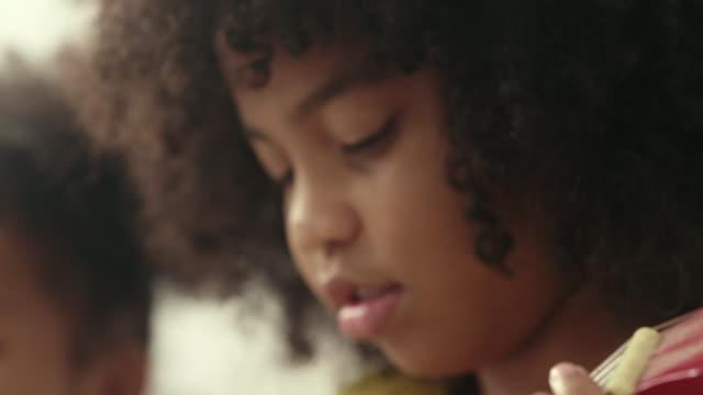 girl playing ukulele - singer stock videos & royalty-free footage