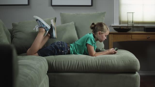 MS ZI Girl (10-11) playing video game / Orem, Utah, USA