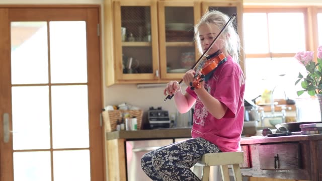 girl playing violin at home - stool stock videos & royalty-free footage