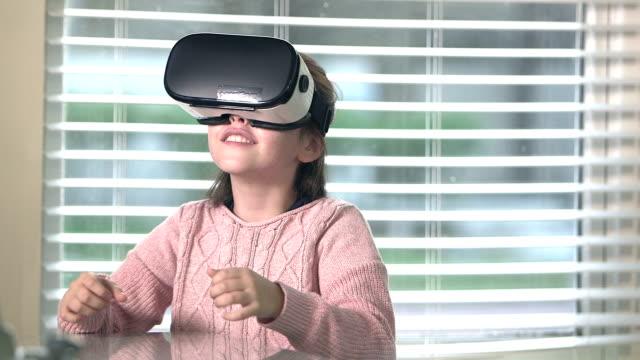 Girl playing virtual reality game
