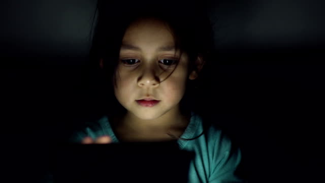 A girl playing with a digital tablet computer