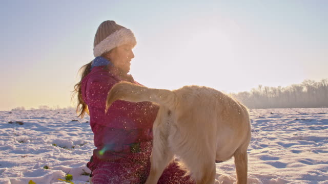 WS Girl Playing With A Puppy In Snow