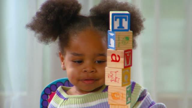 cu, girl (2-3) playing with alphabet blocks, richmond, virginia, usa - preschool child stock videos and b-roll footage