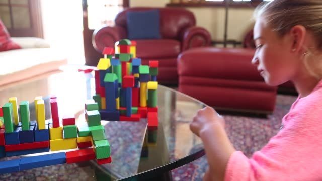 girl playing with blocks - toy block stock videos and b-roll footage