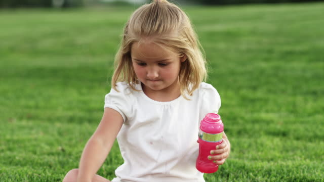ms girl (4-5) playing with bubble wand in park / orem, utah, usa - orem utah stock videos and b-roll footage