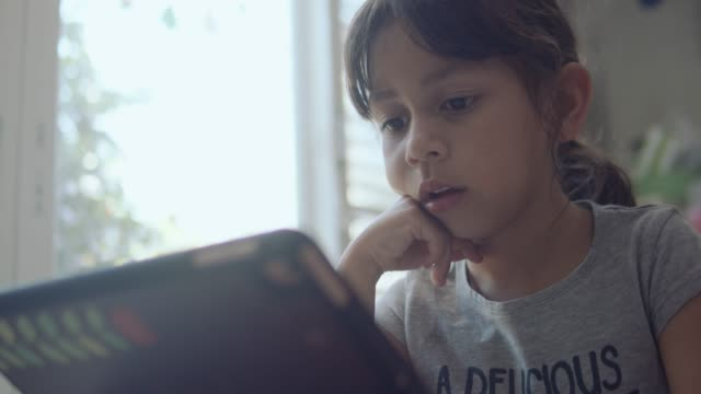 girl playing with digital tablet - one girl only stock videos & royalty-free footage