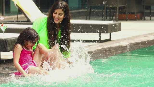 girl playing with her mother at swimming pool, faridabad, haryana, india - daughter stock videos & royalty-free footage