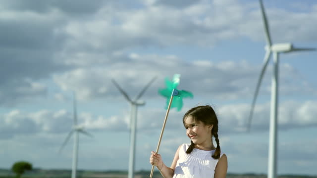 MS Girl playing with toy windmill / Toulouse, Midi-Pyrenees, France