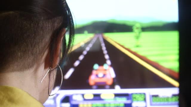 Girl plays racing video game close up