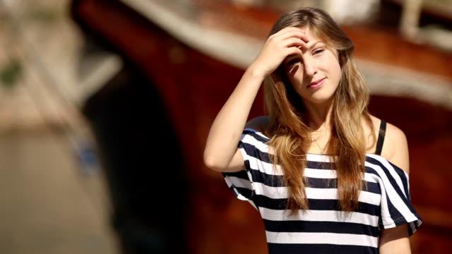 girl posing near the yacht