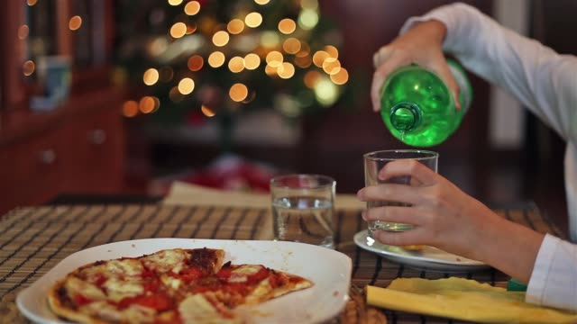girl pouring sparkling water into a glass - parte de una serie video stock e b–roll