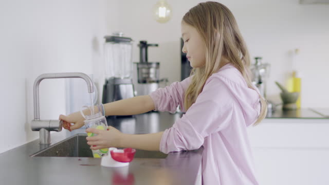girl pouring water - children only stock videos & royalty-free footage