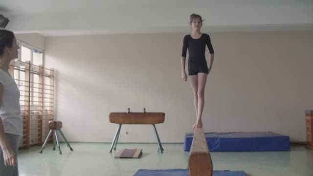 4k: girl practicing gymnastics - gymnastics stock videos & royalty-free footage