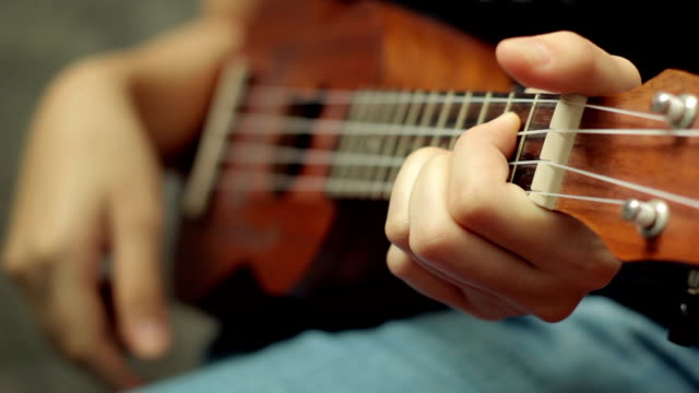 Girl practicing ukulele,Close-up