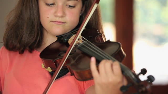 cu tu girl (12-13) practicing violin / richmond, virginia, usa - musical instrument stock videos & royalty-free footage