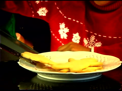 girl preparing cookies for christmas - see other clips from this shoot 1407 stock videos and b-roll footage