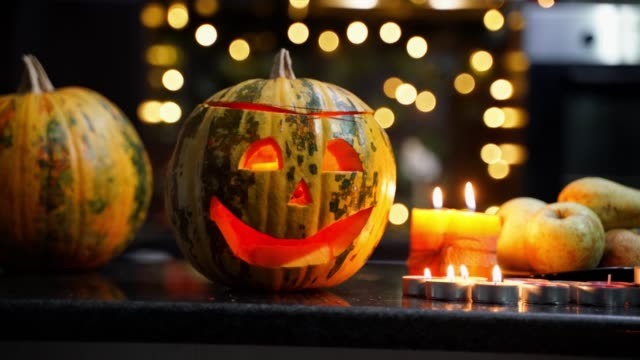 girl preparing decorating halloween set with pumpkin and candles in home - jack o' lantern stock videos and b-roll footage