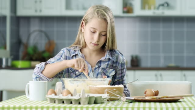 Girl Preparing Food In Kitchen