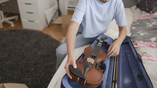 girl preparing her old violin for donation - 10 11 years stock videos & royalty-free footage